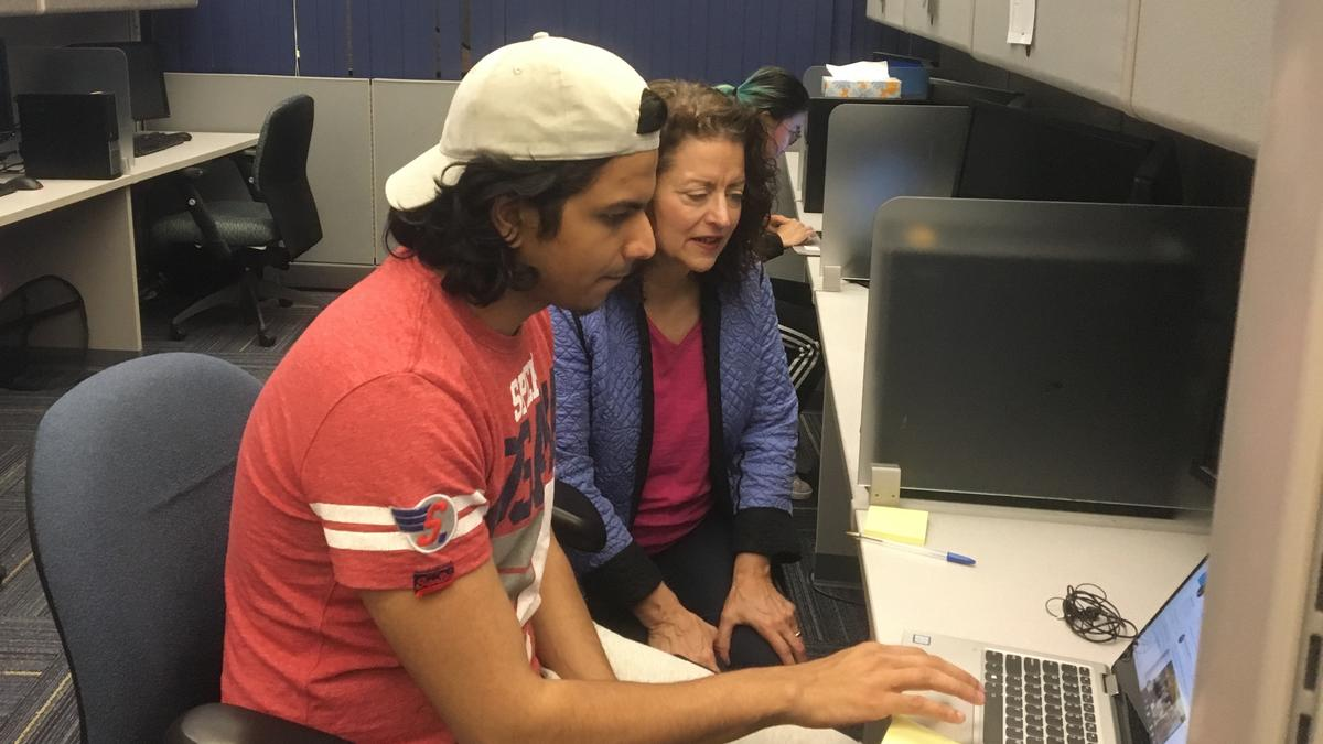 Photo of Anne and Adi using a computer